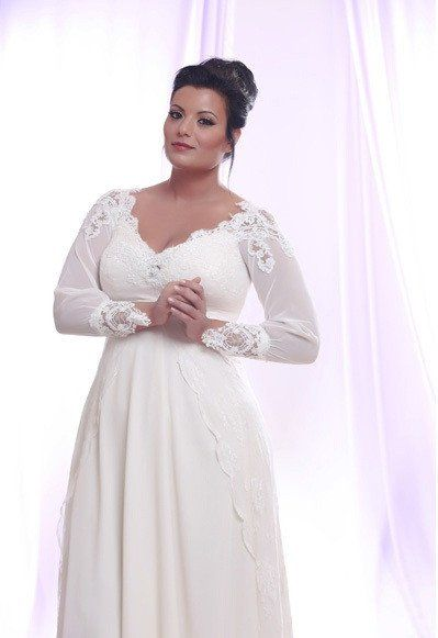 Custom changes are allowed with this long sleeve plus size wedding dress. The v-neck line and empire waist can be adjusted to each brides specific figure and s
