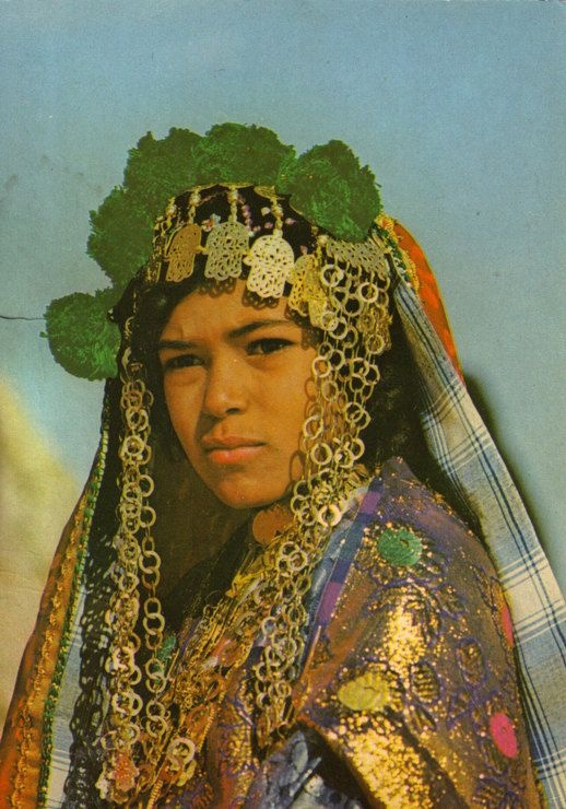 Africa | South Tunisian girl in ceremonial dress.  Postcard stamped 1976.