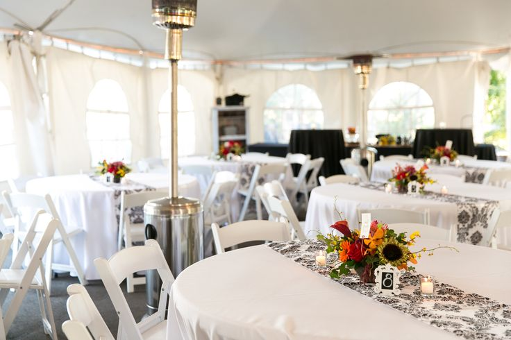 Outdoor tent reception. Stonefields Heritage Farm. Black and white damask pattern  table runners. Colorful centerepices.