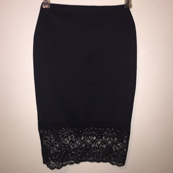 black tube skirt with trim lace at the bottom black tube skirt brand new Never wore it!! Material Girl Skirts Pencil