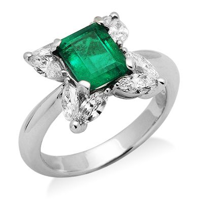 This stylish design will make great for any occasion! Handcrafted in lustrous 18k white gold this ring features a dazzling design with 8 shimmering marquise cut diamonds held at each corner of the frame showcasing the vibrant gemstone held in the center of the frame. The featured gemstone is a genuine radiant cut emerald gemstone held in a secure 4 prong setting. The color of the diamonds are G/H and the clarity is SI2/SI3.