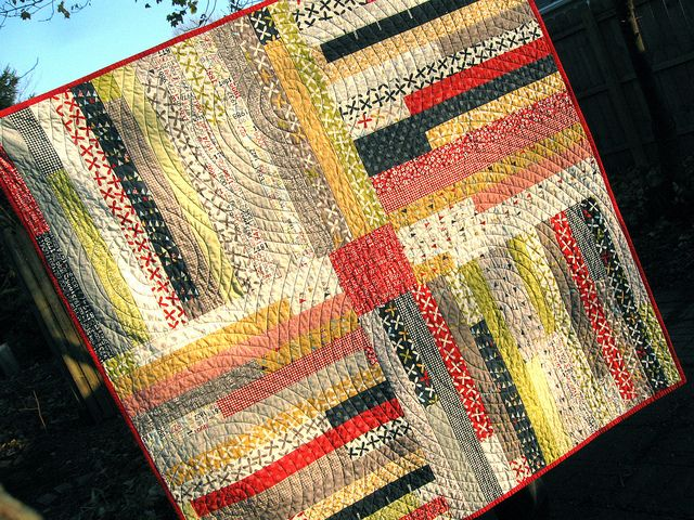Start with Jelly Roll Race quilt until you have 16 rows. Cut the long fabric and then piece together around a fabric square. This site has a link to a tutorial that the quilter put together. She also describes how she did her circular quilting. Love quilters who are helpful and sharing like this one.