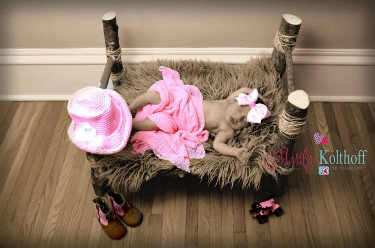 Cowgirl baby girl photo idea. Boots wooden bed photography idea.