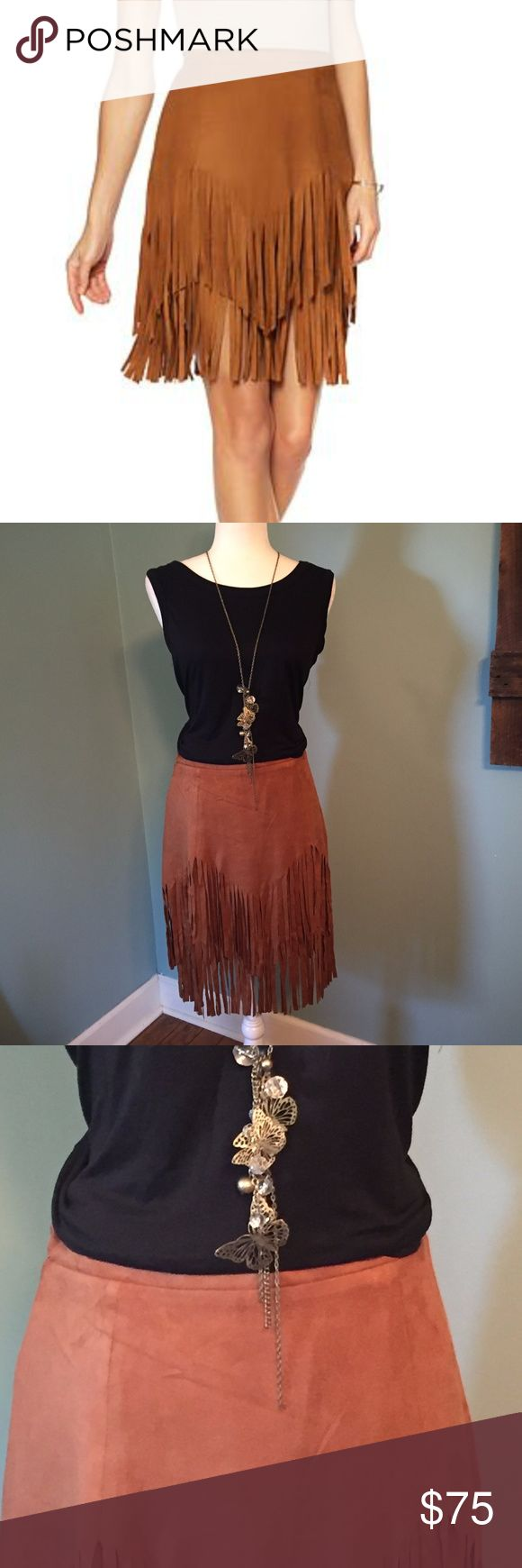 NWT Sheryl Crow Faux Suede Fringe Skirt Sz 8 Sheryl Crow Faux Suede Fringe Skirt  Size 8 in Cognac color.  This skirt is new with tags, is fully lined and has a side zipper. This faux suede fabric is soft to the touch and generates warmth this cold-weather season. The flirty details work together to give your sweaters a run for their style. Top it with blouses, blazers, cardigans and all your coats. See photos for size chart/measurements Sheryl Crow Skirts