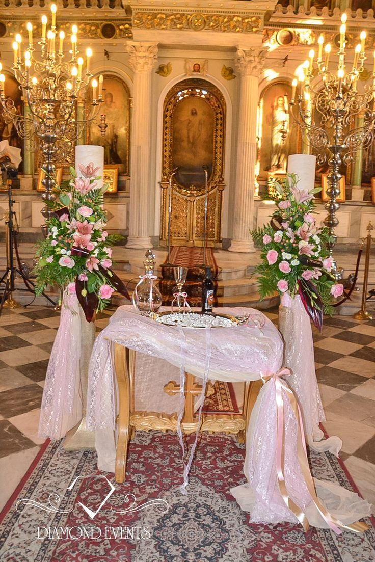 #Impressive #wedding #candles decorated with beautiful #flowers dressed in lace in shades of pink. See more at www.diamondevents.gr