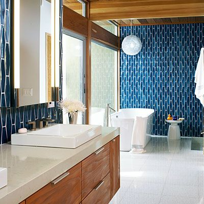 I like this ocean blue tile mixed with the medium colored wood & while fixtures!