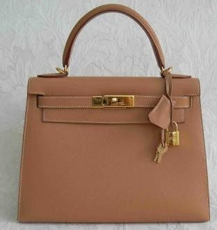 Hermes Kelly bag... sigh......:))  I obviously need it if it's named Kelly!