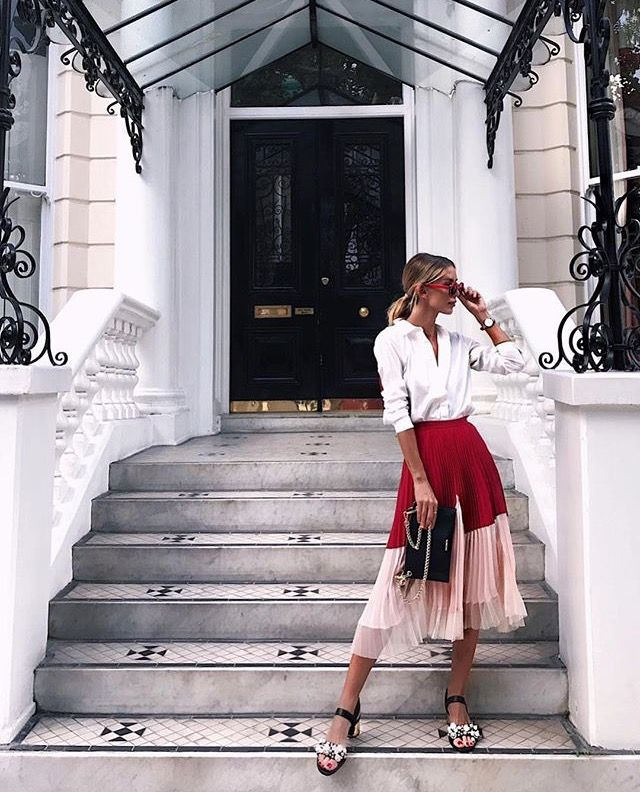 Pink and red skirt with white blouse and bold sunnies