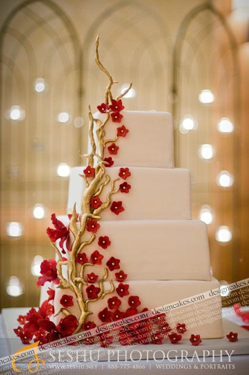 Halle Best, cake designer to the stars! Tiered cake with Red flowers & gold branches. So cute! But I would do yellow and green flowers