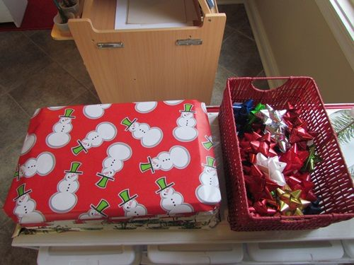 Everyday holiday play in the preschool classroom- magnetic 'boxes' and bows and tags