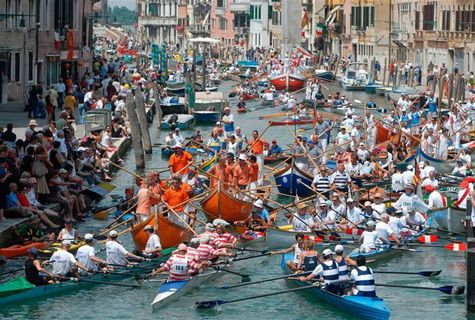 The Vogalonga is a famous regatta that began in Venice in 1974, and takes place each year on a Sunday in May when, for a few hours, the suffocating traffic of motorized boats ceases, and the water is left alone to the oars. \\ The Goldolier's Wife