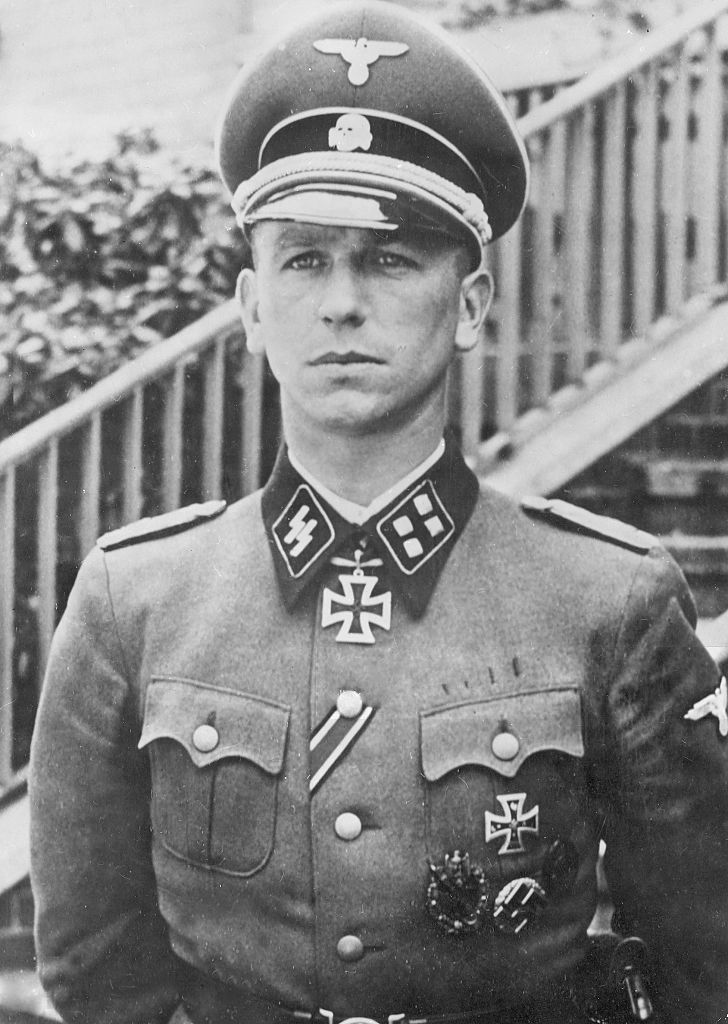 "SS-Sturmbannfuhrer Kurt Meyer (Summer 1941). Nicknamed ""Panzer Meyer"" (1910-1961), he served as an officer in the Waffen-SS during the World War II. He saw action in the invasion of France, Operation Barbarossa, and the Battle of Normandy. After the war, he was put on trial for war crimes relating to the shooting of Allied prisoners in Normandy, for which he was sentenced to death. The sentence was commuted to life imprisonment. He petitioned for clemency and was released in 1954."