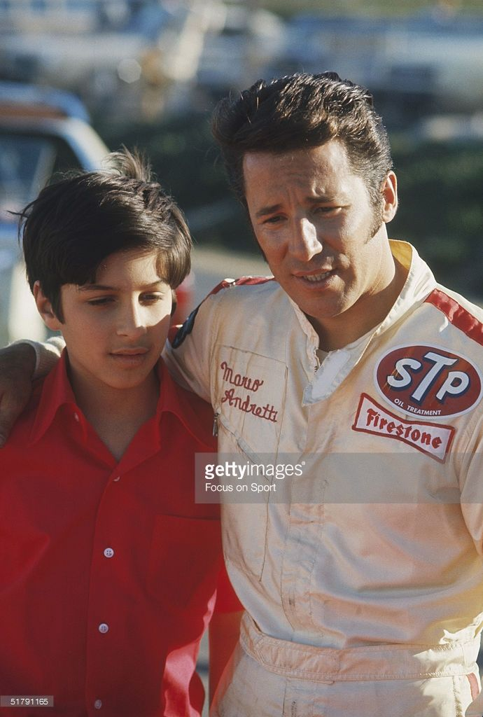 Race car driver Mario Andretti poses with his son Michael Andretti. 1970