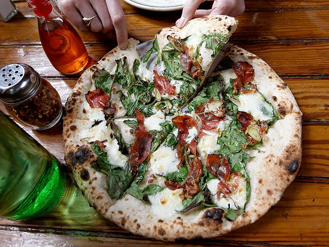 William and Kate's Must-Eat List in New York City | 2. FRESH-FROM-THE-OVEN PIZZA | EDITORS' PICK: Roberta's After they watch the Nets game at Brooklyn's Barclay's arena, Kate and Will should ask their driver to detour to the cultishly popular Roberta's in the borough's up-and-coming Bushwick area. The space might be simple and homespun, but the locally loved wood-fired pizzas (topped with inventive ingredients like raclette cheese and pickled red onions) are utterly unforgettable.