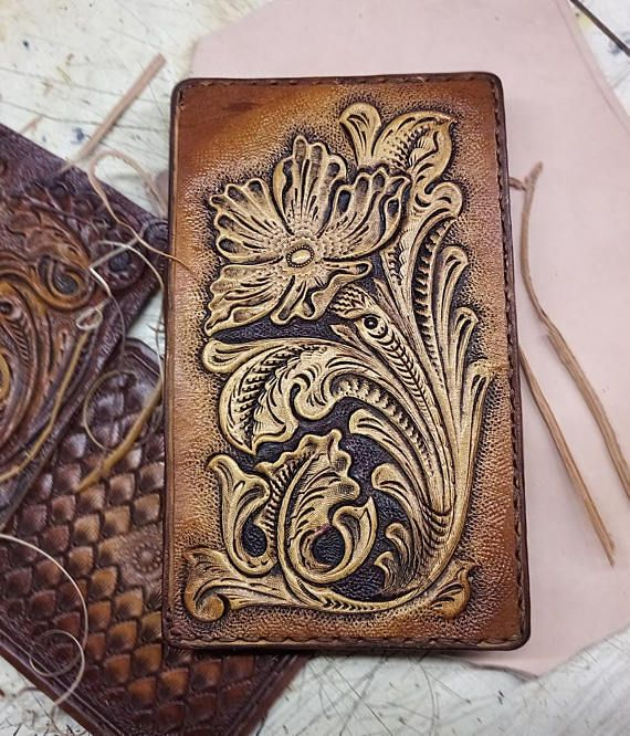 This is the Tooled wallet hand carved floral sheridan western style biker billfold wallet. The outer is made from 8-9 oz. vegetable tanned leather*. It is dyed, covered with a special compound** to protect against moisture, and finished with a clear gloss giving it a lasting shine. The interior