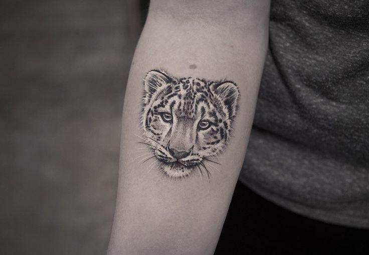 Black and white snow leopard tattoo by LazerLiz