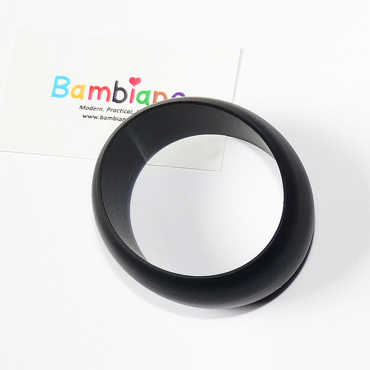 Bambiano Hoola Bangle in Black. Bambiano Bangles are made of 100% Food grade silicone. BPA free, Lead free and nontoxic. Fashionable for Mums and safe for teething babies to chew on. Bracelets are washable and soft on baby's gums. Shop at www.bambiano.com