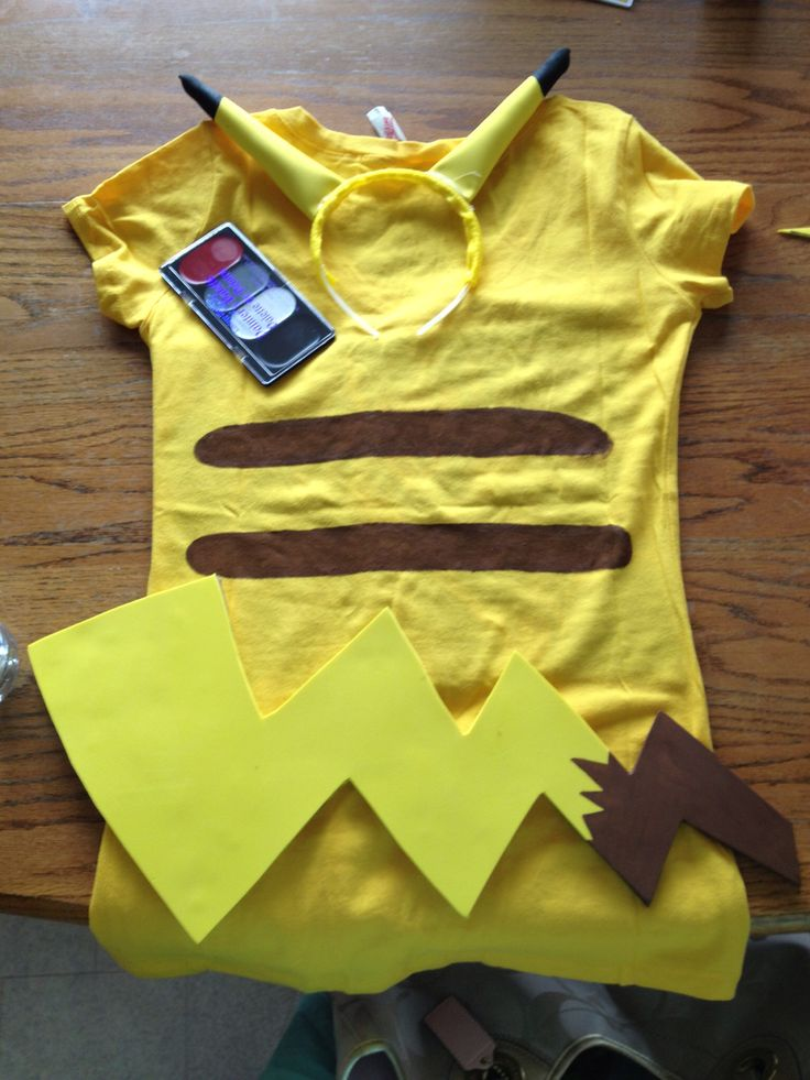 Pikachu costume--yellow shirt with brown stripes, foam tail, yellow headband with stuffed tubes for ears