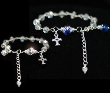 A beautiful gift to give to a little girl on her Christening, First Holy Communion or birthday.  Lucie is a rosary bracelet meaning that it can be worn as a bracelet and also used as a One Decade Rosary.  Finished with a sterling silver clasp. If you wish, the crucifix can be replaced with a crystal drop dangle in the birthstone colour.