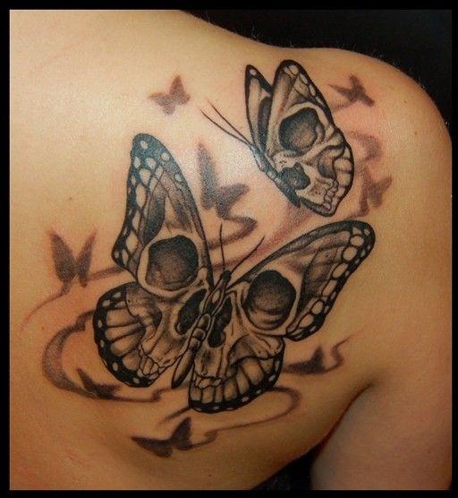 Butterfly Girl Skull Tatoo on Upper Back
