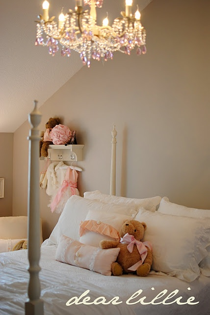 very pretty girls room. Wonder if I can get a chandelier for my girl's big girl room??