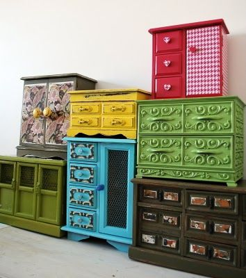 This idea is positively brilliant! make a wall of repainted jewlery boxes and you've got an abundance of storage for lots of small items. A great source would be thrift shops, yard sales, second hand shops or just ask your friends/family if they've got any old 'outdated' jewelry boxes they no longer want. I can envision lots of tiny brass tags stamped and dangling from the drawer pulls and handles-or pretty little tags tied on to identify the contents...