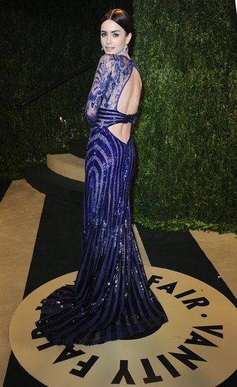 Lily Collins: Lily Collins chose a glittering violet-hued Zuhair Murad confection with a sexy cutout back for the Vanity Fair festivities.
