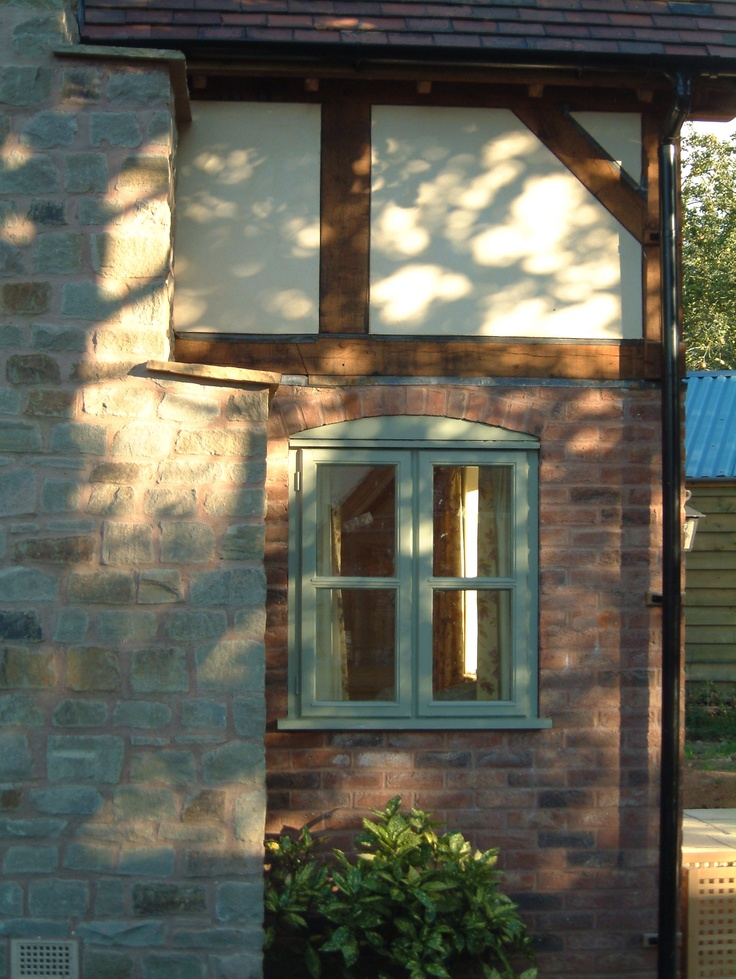 Border Oak - Painted softwood window - beautiful contrast to the brick and oak framing.