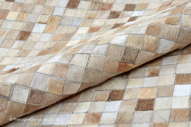 Silva Beige Rug (texture close up), a beige, ivory & brown 100% cowhide leather rug http://www.therugswarehouse.co.uk/everything/silva-beige-rug.html #rugs #interiors #leatherrugs