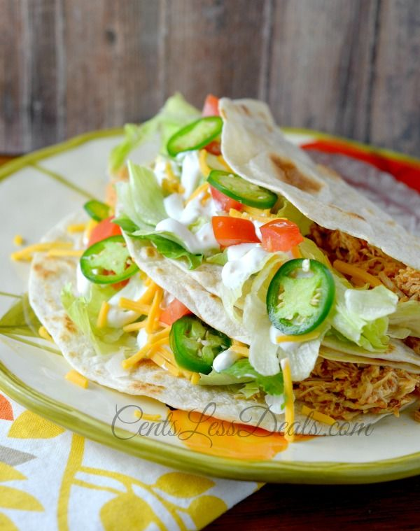 Easy CROCK POT Chicken Tacos recipe!  I can't believe that something with so few ingredients can be SO great!