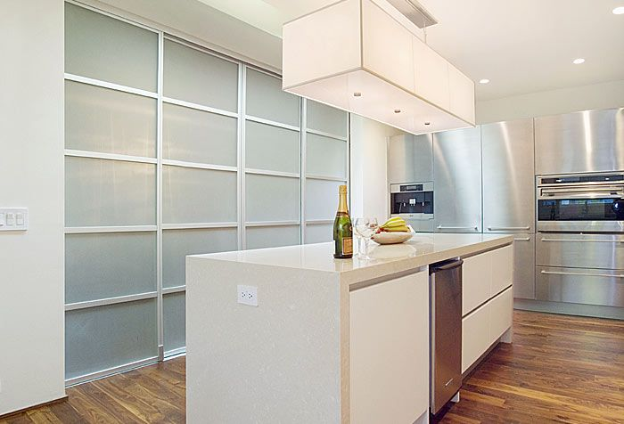 Glass Room Dividers Are A Perfect Solution To Hide Away Your Pantry And Keep Your Kitchen Glass Room Divider Sliding Doors Interior Sliding Door Room Dividers