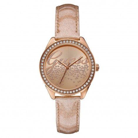 Succombez à la montre très Girly de chez GUESS. La Little Party Girl avec son bracelet en cuir effet pailleté et son cadran rose doré empierré embellira votre Noël.
