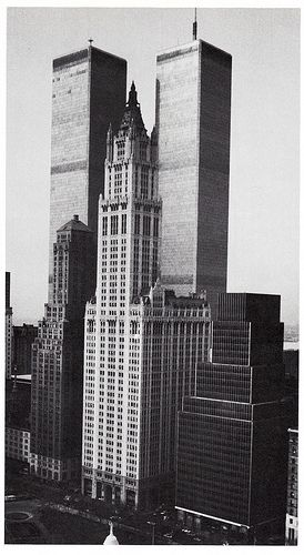 the woolworth building looking southwest from municipal building showing the twin towers of world trade center april 1983