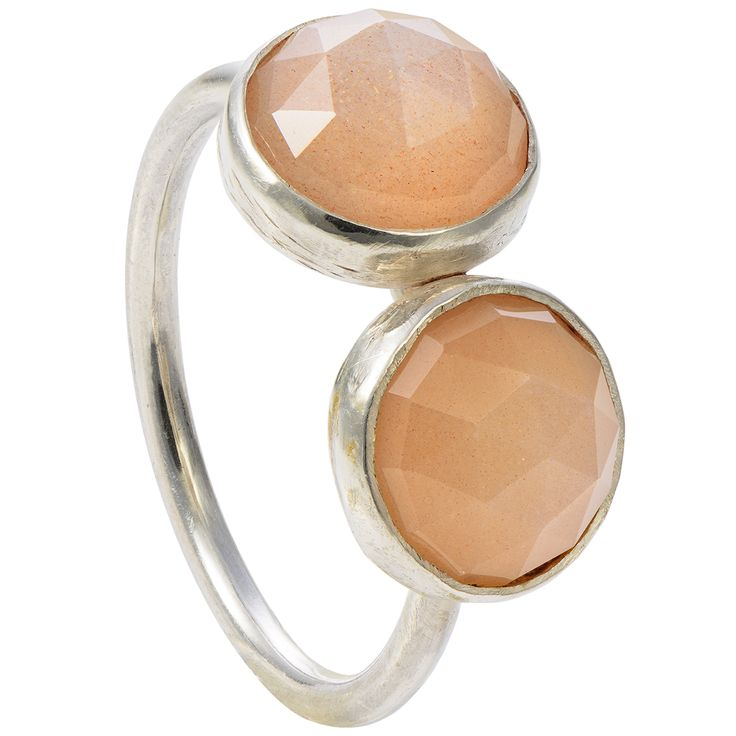 "Two peach moonstone gemstones adorn this simple but powerful ring. The rose cut stones are a substantial size have tiny gold flakes and reflect light on their triangular facets. The side-by-side stones look classy, simple and out of the ordinary.  The faceted cabochons perfectly wrap around the finger, reinforcing a sense of confidence and aspiration. You can wear the ring with a matching necklace from the ""Two"" collection."