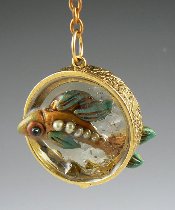 Polymer clay gold fish through the resin.