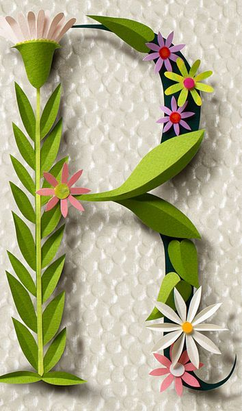 Cut paper floral monogram