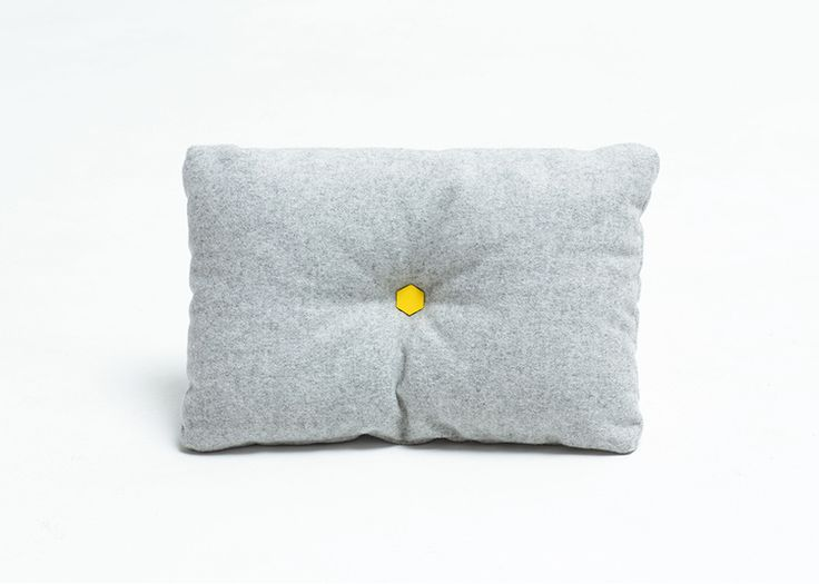 Simple grey cushion with yellow button