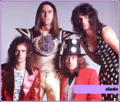 Slade. I wonder if Quiet Riot ever paid them back for giving them, like, their entire CAREER. Cum On Feel the Noize didn't just write itself after MTv arrived...wouldn't it be great if bands still dressed like this?