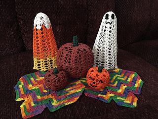 """This is a pattern pack of designs for fall decorating. There is a leaf doily pattern, 2"""" pumpkin pattern with faces optional, 4"""" pumpkin, a ghost and candy corn. It would make a great centerpiece for a fall table. The Leaf measures 7"""" wide by 6"""" tall, 7 1/2"""" including the stem. The Candy Corn and Ghost are about 6"""" tall and 3"""" wide across the bottom and 2"""" deep front to back. They are all very easy to make and they are stiffened over styrofoam forms. All are worked in size 10 crochet thr..."""