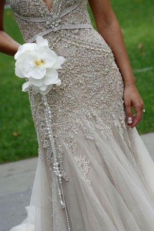 stunning dress, neat bouquet idea