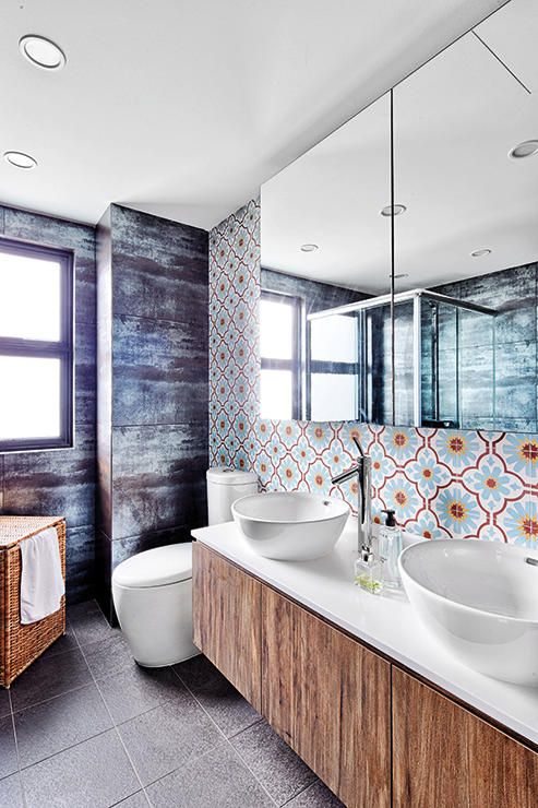 While most will stop at having Peranakan-inspired tiles for a feature wall in the bathroom, the designers decided to throw in tiles that resemble worn iron sheets and raw wood-look laminates to add more visual impact. (Interior design by Free Space Intent)