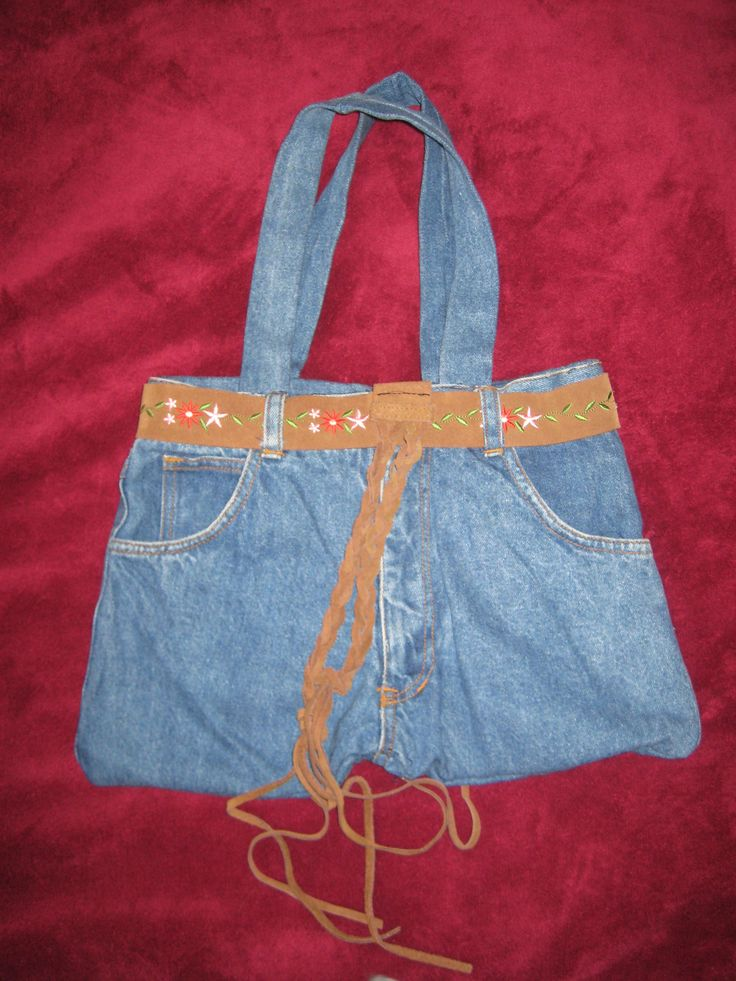 An old pair of jeans and belt made into a hand bag