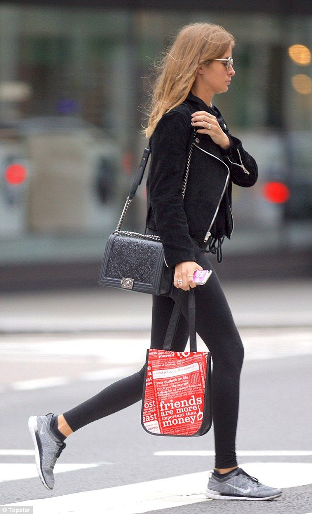 Wearing her heart on her bag: The star carried a slogan tote with the wise words 'friends are more important than money'