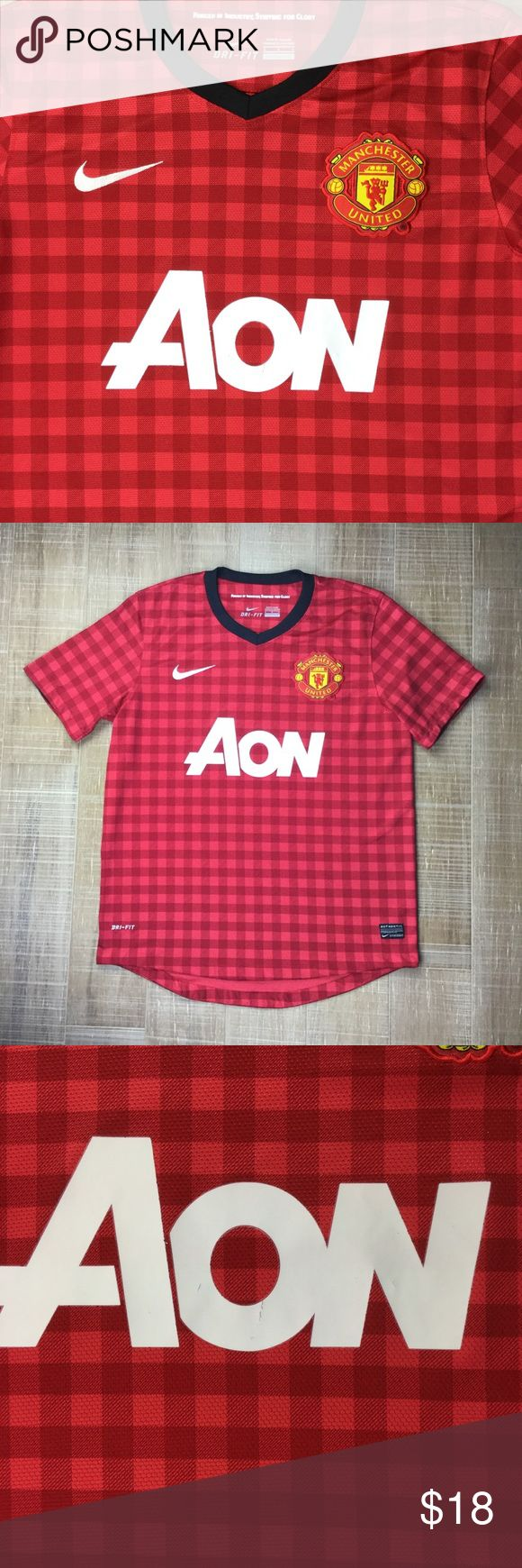 NIKE Manchester United Plaid Home Soccer Jersey Nike Dri-Fit Manchester United Home Plaid Soccer Jersey, Sz Small. Manchester United badge over the heart. Good pre-owned condition. Has a few small flaws—slight cracking in AON lettering (photo 3), small pinhole on seem of sleeve (photo 6), some small interior snags in front (not very visible when wearing; photo 7) & one very small part of hem seen underneath is unattached (photo 8). No fabric contents tag—100% recycled poly. Smoke free home…
