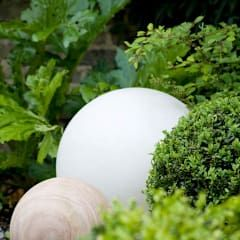 Illuminated & Stone Spheres.: modern Garden by Earth Designs
