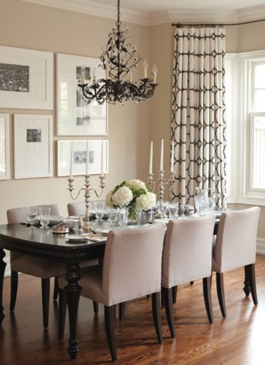 Dining room table and chairs.  wall art. white on white.