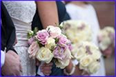 A stunning design for a bridal bouquet of pale and dark pinks with ivory and foliage