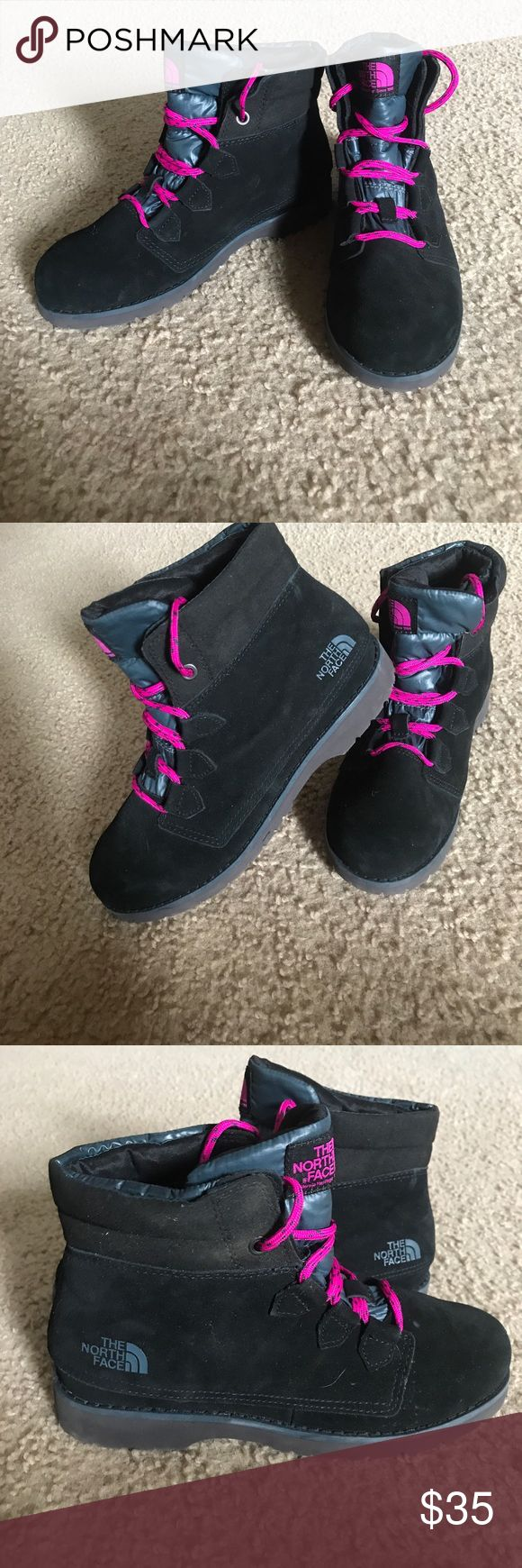 North Face Snow Boots Black North Face Snow Boots with pink laces. Only worn once for an hour, still in fabulous condition!! Basically look brand new! Size 7 in women's, true to size. Have thermal covering inside to keep your feet warm and have great soles to prevent you falling on ice. North Face Shoes Winter & Rain Boots