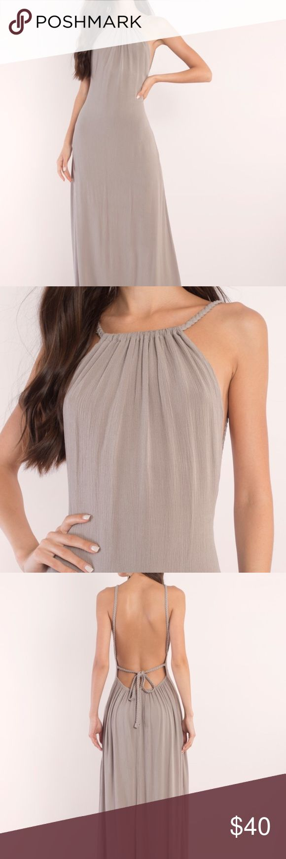 Lake grey halter maxi dress Beautiful halter dress that's perfect for date night, weddings, or a night out on the town. Ties in the back. Maxi length. Never worn so asking what I paid for it. Tobi Dresses Maxi