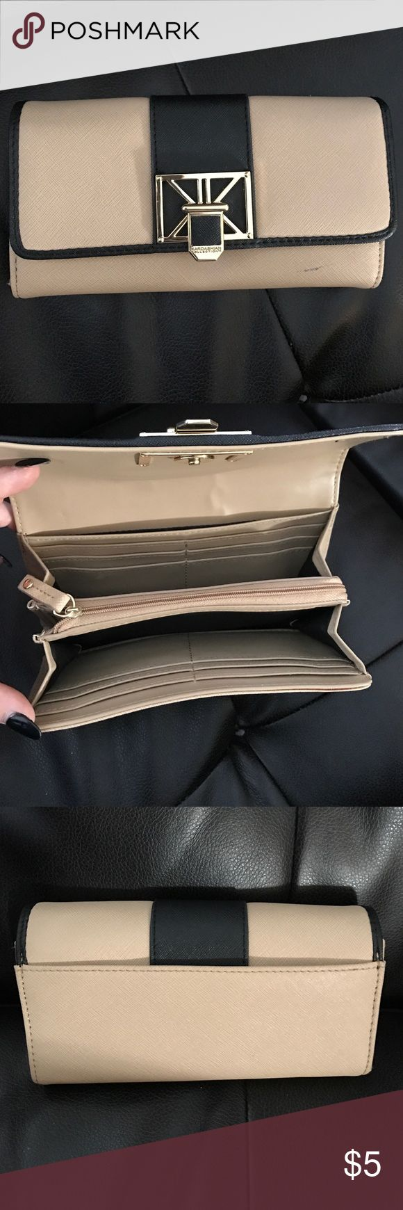 Kardashian Kollection wallet Stylish Kardashian Kollection wallet goes with a variety of colors. Tons of space for credit cards and a zip pocket that could be used for change. Bags Wallets